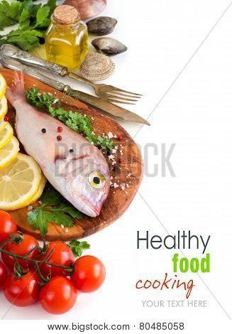Fresh Fish On A Wooden Board