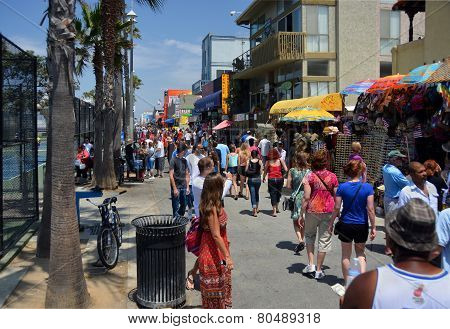 Crowds Visit The Stalls On Venice Beach Boardwalk.