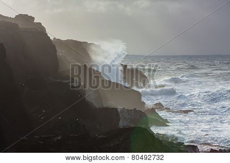 Big waves breaking on cliffs during winter storm on the west coast of Ireland.