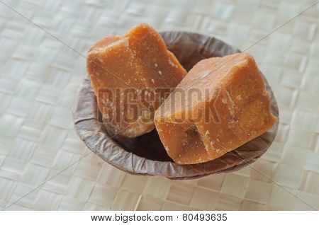 Gud - An Indian jaggery blocks in an earthen bowl