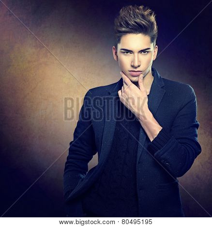 Fashion young model man portrait. Handsome Guy. Vogue style image of elegant young man. Studio fashion portrait.