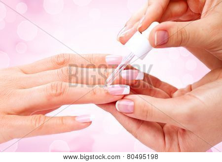 Manicure, Hands spa Cuticle oil. Beautiful Woman hands closeup. Manicured nails and Soft skin. Beauty hands. Beauty treatment. Beautiful woman's nails with beautiful french manicure