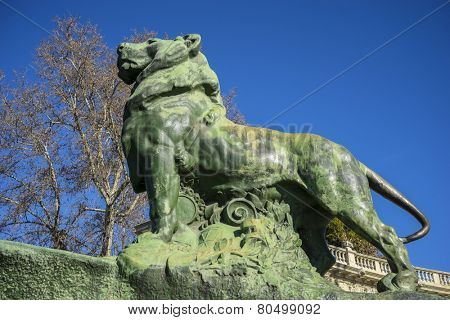 Lion, classical bronze sculptures, Lake in Retiro park, Madrid Spain