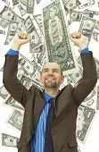Happy businessman on the money background poster