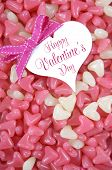 stock photo of jelly beans  - Valentines Day pink and white heart shape jelly candy confectionary on pink wood background with heart greeting card and sample text  - JPG