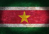 picture of suriname  - Old rusty metal sign with a flag  - JPG