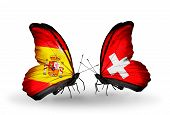 stock photo of spanish money  - Two butterflies with flags on wings as symbol of relations Spain and Switzerland - JPG