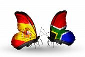 stock photo of spanish money  - Two butterflies with flags on wings as symbol of relations Spain and South Africa - JPG