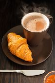 stock photo of apricot  - breakfast croissant apricot jam and cup of coffee and milk - JPG