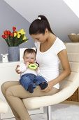 foto of lap  - Pretty young mother holding baby boy on lap - JPG