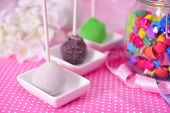 stock photo of cake pop  - Sweet cake pops on table on bright background - JPG