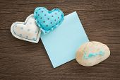 picture of wood craft  - Blue hearts handmade crafts from polka dot cotton cloth with love word on pebble and blank paper note place on wood background with vignette anniversary and valentine - JPG