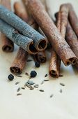 stock photo of cumin  - Many Cinnamon sticks cumin seeds and black pepper - JPG