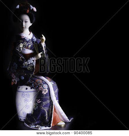 Japanese doll geisha in kimono