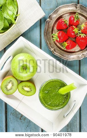 A Green Smoothie With Fruit And Spinach