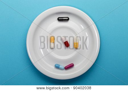 Six capsules colorful  on a plate