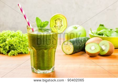 A Green Smoothie With A Drinking Straw