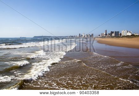 Incomming Tide At Durban Beach With Hotels In Background