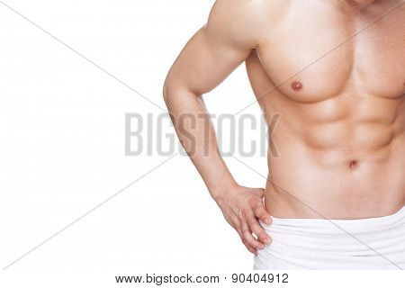Fit muscular man in towel, isolated on white background