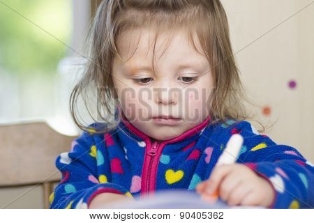 Little Girl Whose Face  Is Smudged With Paint