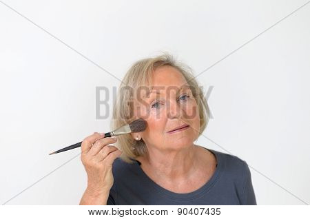 Attractive Middle-aged Woman Applying Makeup