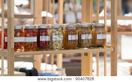 Fresh Spices In Sealed Jars At A Farmer's Market