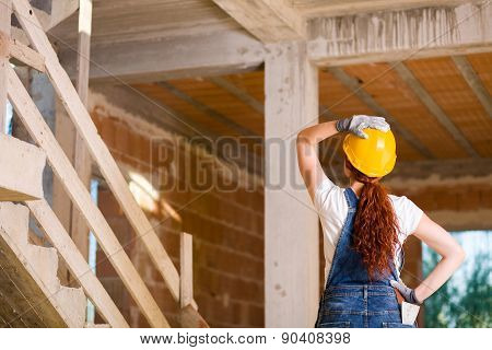 Woman Bricklayer Watching Upstairs