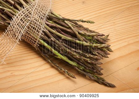 Fresh Wild Asparagus On A Wooden Table Ready To Be Cooked