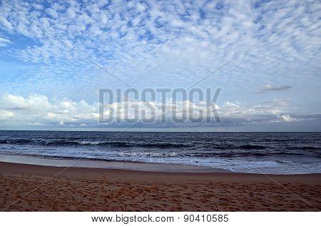 Beach And Blue Cloudy Sky By The Sea On Sundown
