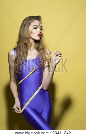 Slim Beautiful Girl With Tape Measure