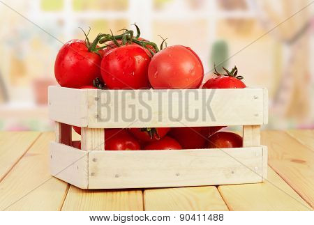 Tomatoes in wooden crate