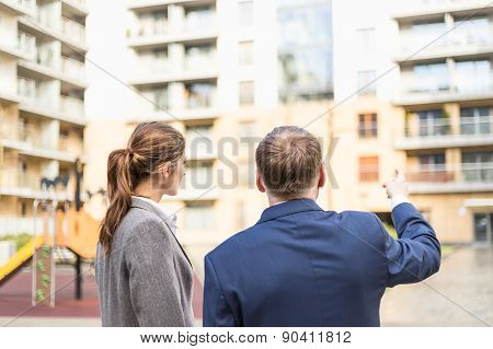 Businessman Presenting A New Apartment To Businesswoman