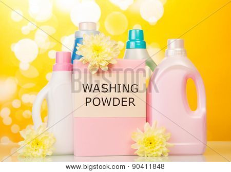 Washing powder and Cleaning items on yellow