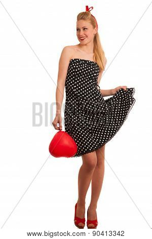 Retro Style Pin Up Girl With Blonde Hair In Black Dress Wtih White Dots Isolated Over White Backgrou