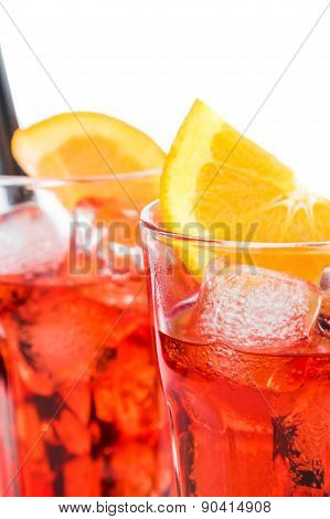 Close-up Of Two Glasses Of Spritz Aperitif Aperol Cocktail With Orange Slices And Ice Cubes Isolated