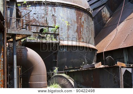 Plants And Trees Growing In Rusting Industrial Site