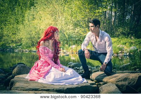 Fairy Tale Couple Sitting on Large River Rocks