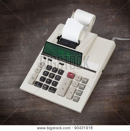 Old Calculator Showing A Percentage - 75 Percent