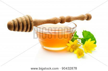 Honey With Wooden Dipper And Yellow Flowers