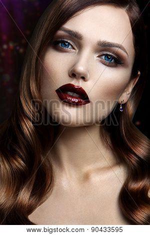 Portrait of beautiful girl with dark lips.