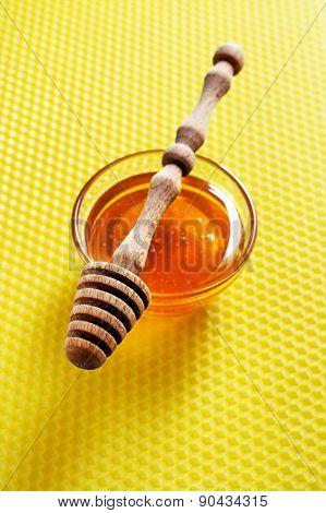 Honey On Honeycomb Background