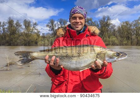 Happy Fisherman With Big Fish. Fishing. Fish Perch. Trophy.