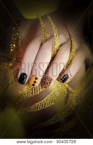 Black and yellow manicure.