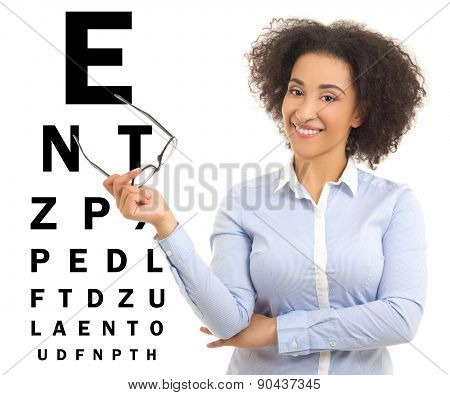 Beautiful African American Woman With Glasses And Eye Test Chart Isolated On White