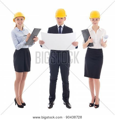 Team Work Concept - Business People In Yellow Builder's Helmets With Blueprint Isolated On White