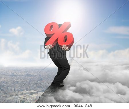 Man Carrying Red Percentage Sign On Ridge With Cloudscape Cityscape