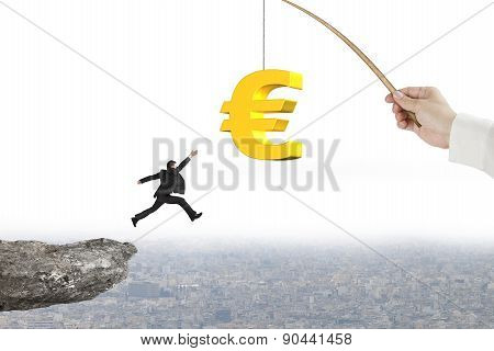 Man Jumping Golden Euro Symbol Fishing Lure With Cliff Cityscape