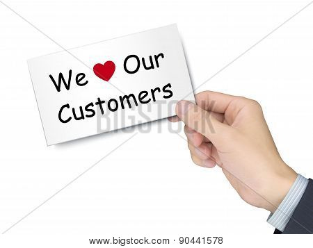 We Love Our Customers Card In Hand
