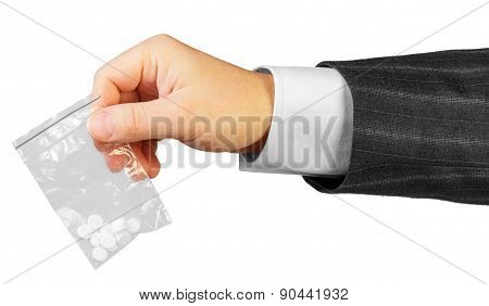 Male hand with package of drugs