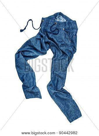Blue Jeans In Motion Fall In The Air On An Isolated White Background